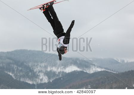 BUKOVEL, UKRAINE - FEBRUARY 23: Alexei Grishin, Belarus performs aerial skiing during Freestyle Ski World Cup in Bukovel, Ukraine on February 23, 2013.