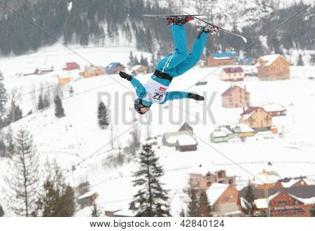 BUKOVEL, UKRAINE - FEBRUARY 23: Sergei Berestovskiy, Kazakhstan performs aerial skiing during Freestyle Ski World Cup in Bukovel, Ukraine on February 23, 2013.
