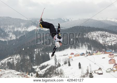 BUKOVEL, UKRAINE - FEBRUARY 23: Jonathon Lillis, USA performs aerial skiing during Freestyle Ski World Cup in Bukovel, Ukraine on February 23, 2013.