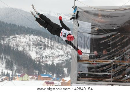 BUKOVEL, UKRAINE - FEBRUARY 23: Serhiy Berchun, Ukraine performs aerial skiing during Freestyle Ski World Cup in Bukovel, Ukraine on February 23, 2013.