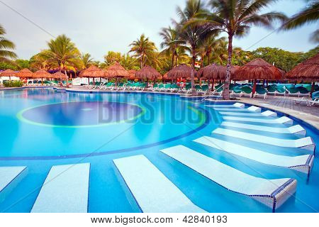 PLAYA DEL CARMEN, MEXICO - JULY 12, 2011: Scenery of luxury swimming pool at RIU Yucatan Hotel on July 12, 2011 in Playa del Carmen. RIU Hotels & Resorts has more than 100 hotels in 19 countries.