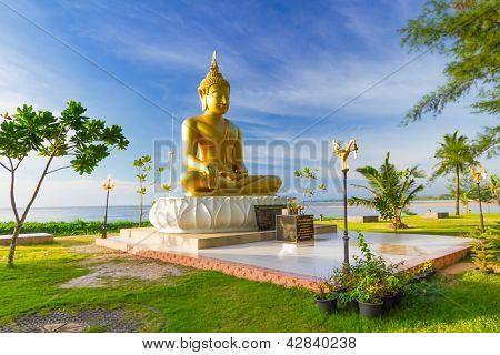PHANG NGA, THAILAND - NOV 15: Statue of golden Buddha Buddha that sits back to the sea and directly to the Ban Nam Khem Tsunami Memorial Park. Pilgrimage site in Phang Nga, Thailand, Nov.15, 2012