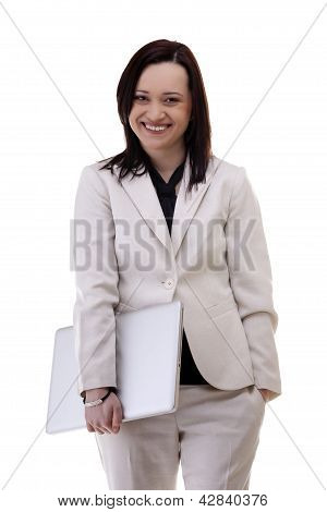Smiling Businesswoman In White Suite With A Laptop In Her Hands Isoalted On White