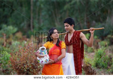 Asian Rural Couple Standing In Their Filed