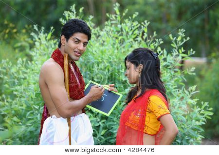 An Asian Rural Couple Learning To Read And Write