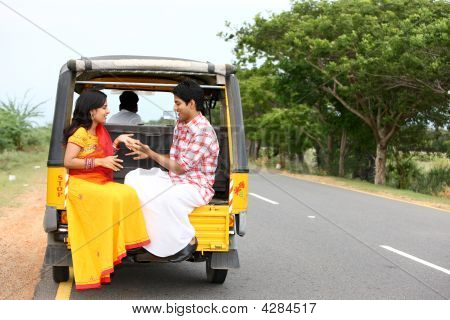 An Asian Couple Traveling In A Phut-phut