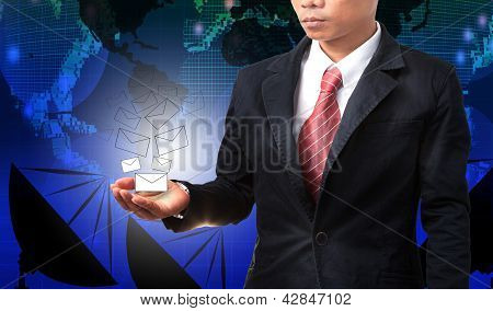 Business Man Holding White Envelope Of Data And Information With Graphic Blue World Map