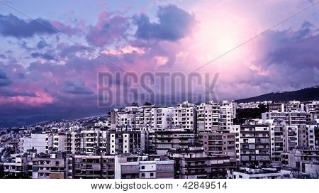 Picture of beautiful purple sunset over city, peaceful landscape, architecture in Lebanon, arabian buildings, panorama of downtown, cloudy sky, pink sunrise, travel and tourism concept