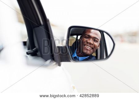 male african american driver looking at rear mirror