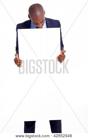 black businessman holding empty banner and looking down
