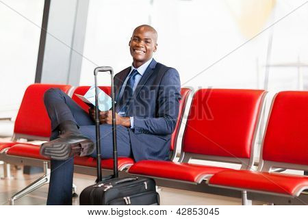 african american businessman waiting flight in airport