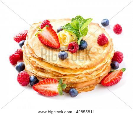 Pancake. Crepes With Berries. Pancakes stack with Strawberry, Raspberry, Blueberry  isolated on a White Background