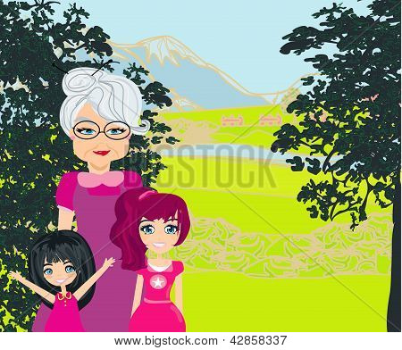 Grandmother With Grandchildren On A Walk In The Park