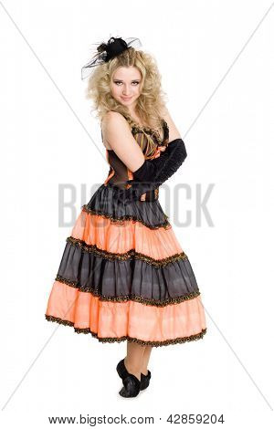 Young charming blonde girl standing on her toes in dance.