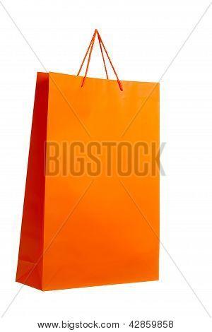 Orange paper bag on white.