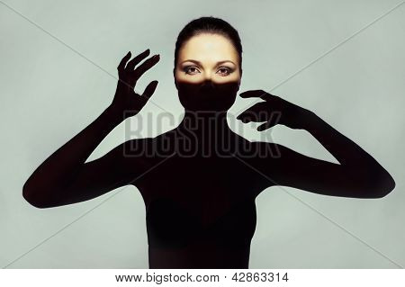 Surrealist art portrait of young lady with shadow on her body