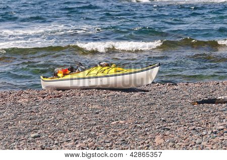 Sea Kayak On An Remote Ocean Beach