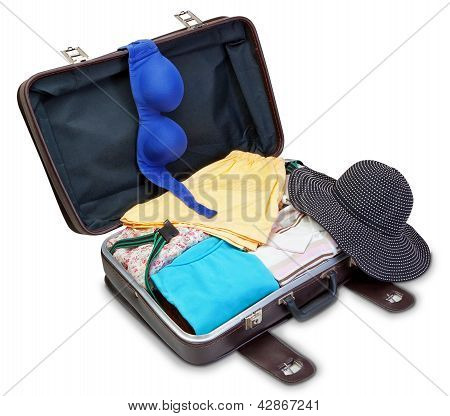 Brassiere And Panama On A Suitcase For A Holiday. On A White Background.