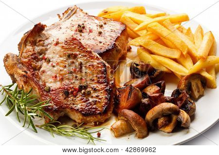 Fried pork chop, chips and vegetable salad