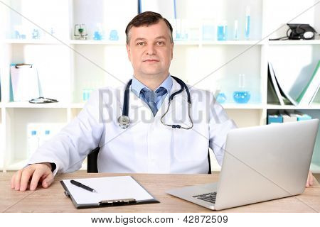 Medical doctor working at desk