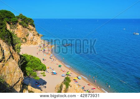 CALELLA, SPAIN - AUGUST 17: La Roca Grossa Beach on August 17, 2011 in Calella, Spain. The Catalan coast, where is Calella, is the destination of millions of tourists in the summer