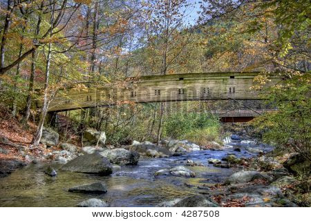Wooden Bridge Over Mountain Stream