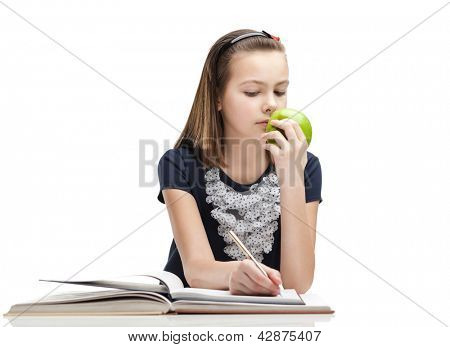 Pupil is eating a ripe apple while studying, isolated, white background
