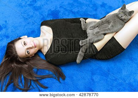 Beautiful Girl With A Cat On Hands