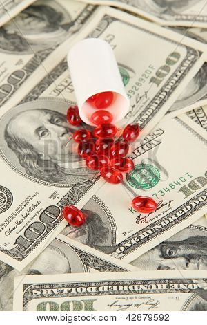 Pills and money close-up background