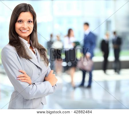 Business woman portrait smiling in an officeq