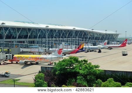 SHANGHAI, CHINA - MAY 27: Airplane at terminal on May 27, 2012 in Shanghai, China. Pudong airport is the busiest international hub of mainland China, third busiest by cargo traffic in the world.