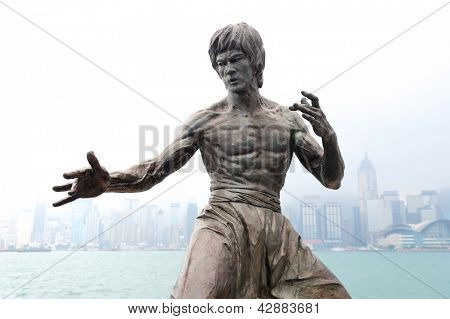 HONG KONG, CHINA - APR 17: Bruce Lee Statue in Avenue of Stars on April 17, 2012 in Hong Kong, China. The promenade honours celebrities of the Hong Kong film industry as the famous city attraction.