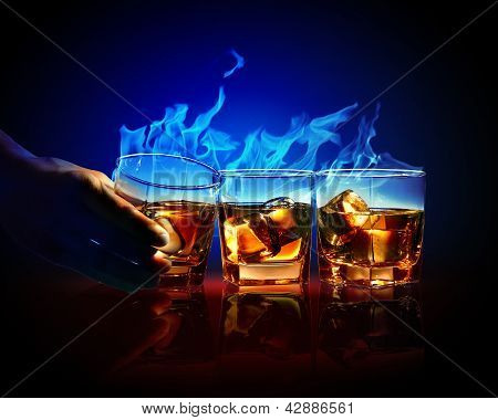 Three glasses of burning yellow absinthe