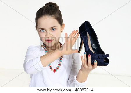 Little fashionista holding shoe