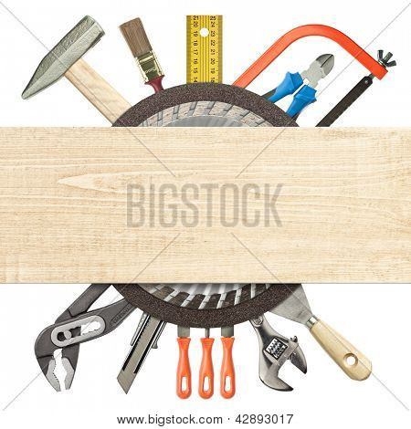 Carpentry, construction collage. Tools underneath wood plank.