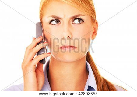 A portrait of a worried woman talking on the phone