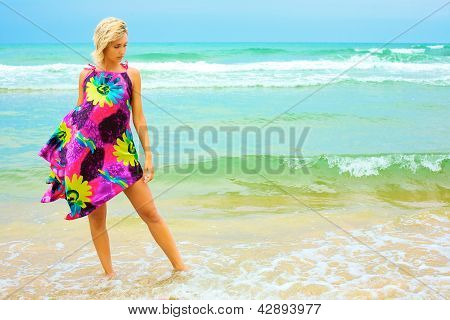 Young Woman In Dress On Beach