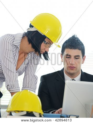 Architects having discussion about new business project using laptop