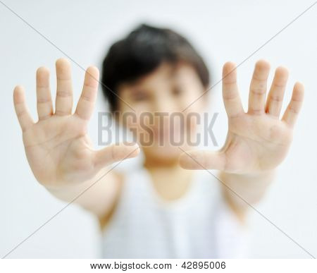 Cheerful little boy showing his empty hand