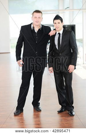Portrait of two young businessmen colleagues