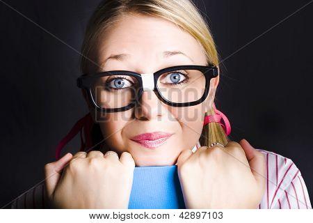 Face Of Smart Schoolgirl Holding Textbook On Black