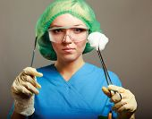 picture of scalpels  - Portrait of young woman doctor surgeon  - JPG