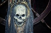 stock photo of eye-sockets  - Pirate skull on ship - JPG