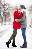 foto of outerwear  - Young couple kissing on winter day - JPG