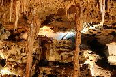 stock photo of calcite  - Inside view of an underground cavern or cave with stalagmites and stalactites - JPG