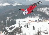 BUKOVEL, UKRAINE - FEBRUARY 23: Mischa Gasser, Switzerland performs aerial skiing during Freestyle S