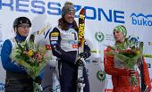 BUKOVEL, UKRAINE - FEBRUARY 23: Emily Cook, USA (center), Nadiya Didenko, Ukraine (left) and Tanja S