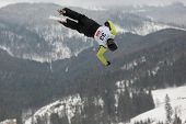 BUKOVEL, UKRAINE - FEBRUARY 23: Sergii Lysianskyi, Ukraine performs aerial skiing during Freestyle S