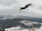 BUKOVEL, UKRAINE - FEBRUARY 23: Michael Rossi, USA performs aerial skiing during Freestyle Ski World