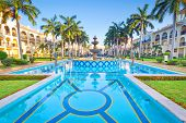 PLAYA DEL CARMEN, MEXICO - JULY 11, 2011: Scenery of luxury swimming pool at RIU Palace Hotel on Jul